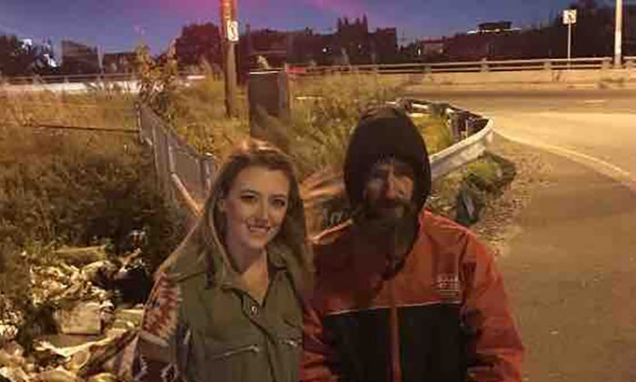 Kate McClure and John Bobbitt stand near the spot by I-95 where they say he helped her when she ran out of gas in a story later exposed as fabricated in court. (GoFundMe)