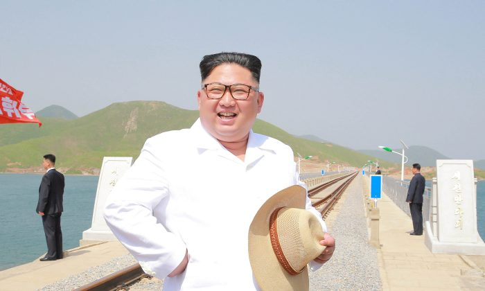 North Korean leader Kim Jong Un inspects the completed railway that connects Koam and Dapchon, in this undated photo released by North Korea's Korean Central News Agency (KCNA) in Pyongyang on May 24, 2018. (KCNA/via Reuters)