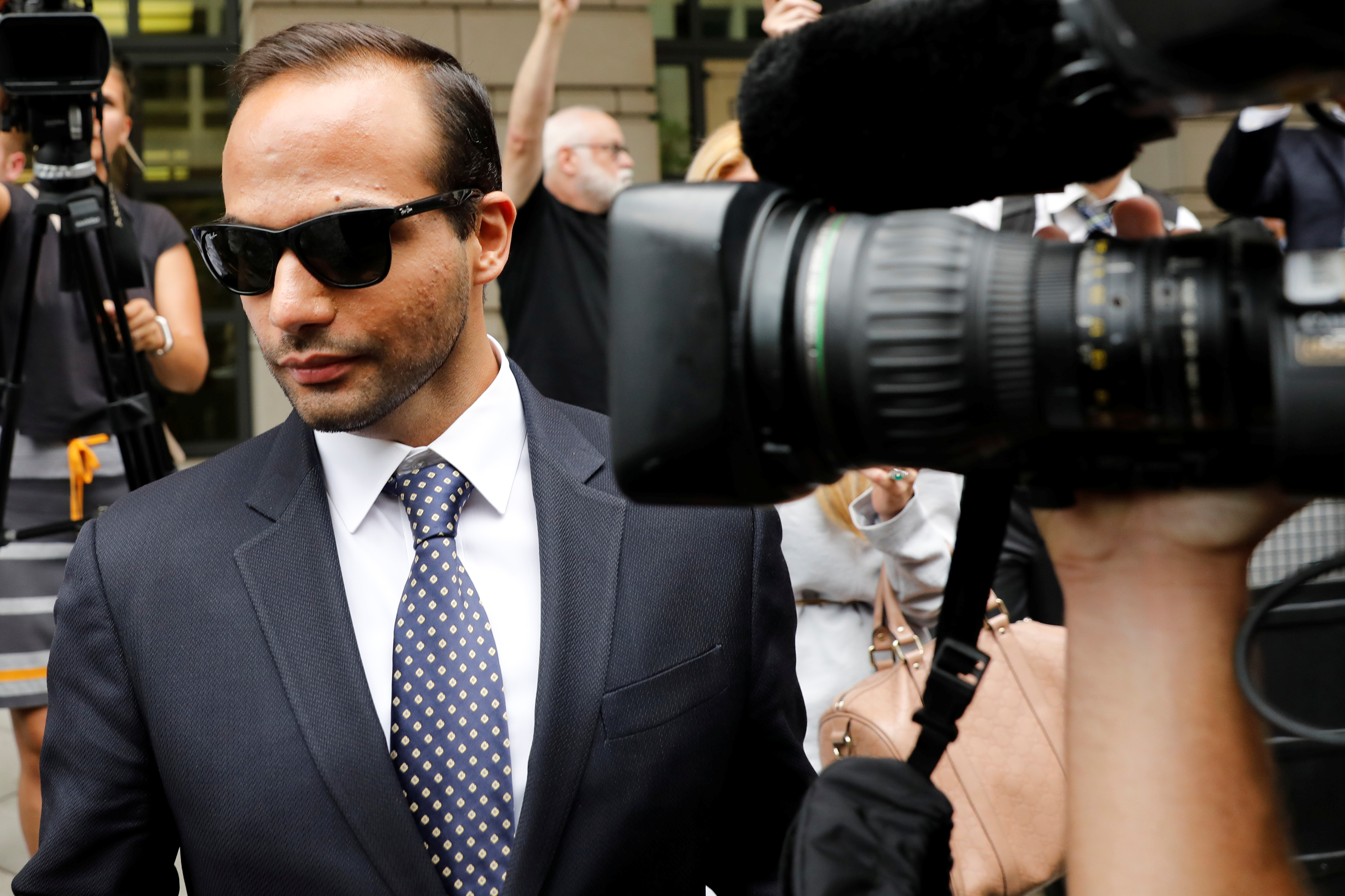 Former Trump campaign aide George Papadopoulos leaves after his sentencing hearing at U.S. District Court in Washington