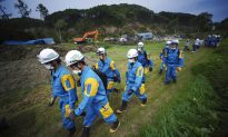 Japan Quake Toll up to 18 as Rescuers Dig Through Landslides
