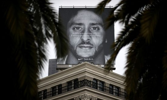10c06c165 A billboard featuring former San Francisco 49ers quaterback Colin  Kaepernick is displayed on the roof of