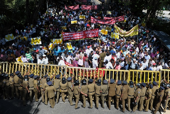 Sri Lankan police stand guard during a protest against the proposed sale of a stake in a loss-making port to a Chinese company in Colombo on February 1, 2017. (ISHARA S. KODIKARA/AFP/Getty Images)
