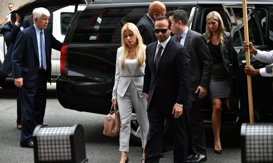 Former advisor to US President Donald Trump's election campaign, George Papadopoulos and his wife Simona Mangiante Papadopoulos arrive at US District Court in Washington on Sept. 7, 2018. (Mandel Ngan/AFP/Getty Images)