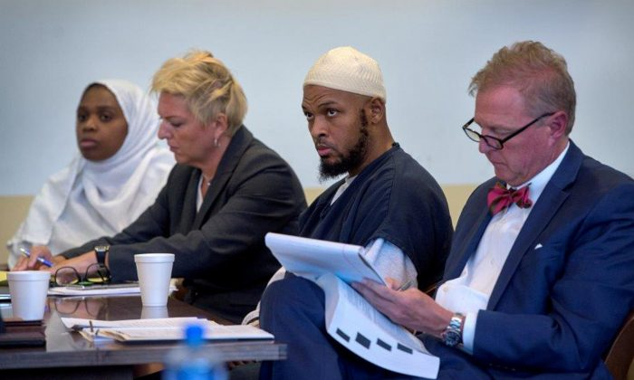 Jany Leveille (L to R) next to her defense lawyer, Kelly Golightley, defendant Siraj Ibn Wahhaj, and his defense lawyer, Tom Clark, at a hearing in Taos County District Court in Taos County, N.M., on Aug. 29, 2018. (Eddie Moore/Pool via Reuters)
