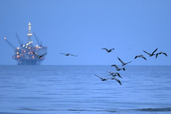 an oil-drilling platform above an oil slick along the coast of Refugio State Beach in Goleta, Calif.