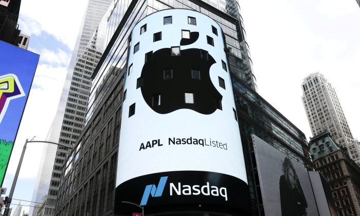 An electronic screen displays the Apple Inc. logo on the exterior of the Nasdaq Market Site in New York City on Aug. 2, 2018. (Reuters/Mike Segar)