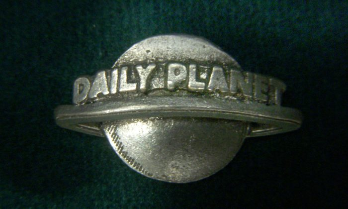 """A """"Daily Planet"""" pin is pictured on May 20, 2009. (JD Hancock/Flickr, CC BY 2.0 https://creativecommons.org/licenses/by/2.0/)"""