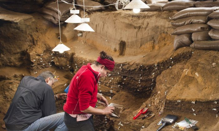 This undated photo provided by Magnus M. Haaland in September 2018 shows researchers in the interior of the Blombos Cave east of Cape Town, South Africa. In a report released on Sept. 12, 2018, scientists say a tiny 73,000-year-old sketch found in this South African cave is the oldest known drawing. (Magnus M. Haaland via AP)