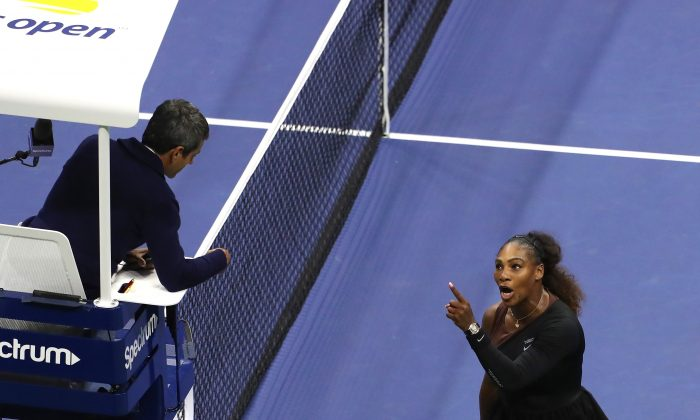 Serena Williams yells at umpire Carlos Ramos during her Women's Singles finals match against Naomi Osaka of Japan in New York City on Sept. 8, 2018. (Jaime Lawson/Getty Images for USTA)