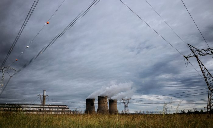 The towers of an Eskom power plant in the Hendrina settlement, South Africa, on Feb. 22, 2018. (Marco Longari/AFP/Getty Images)