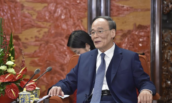 Chinese vice chairman Wang Qishan during a diplomatic meeting at the Zhongnanhai Leadership Compound in Beijing on March 23, 2018. (Parker Song/AFP/Getty Images)