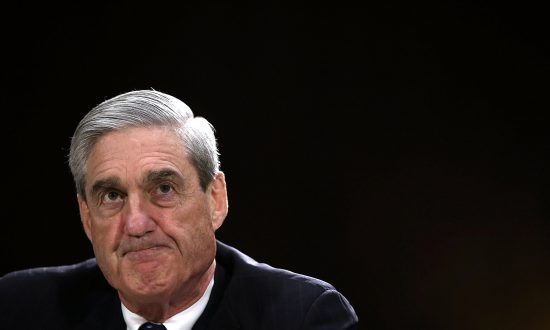 Then-Federal Bureau of Investigation Director Robert Mueller testifies during a hearing before the Senate Judiciary Committee on Capitol Hill in Washington on June 19, 2013. (Alex Wong/Getty Images)