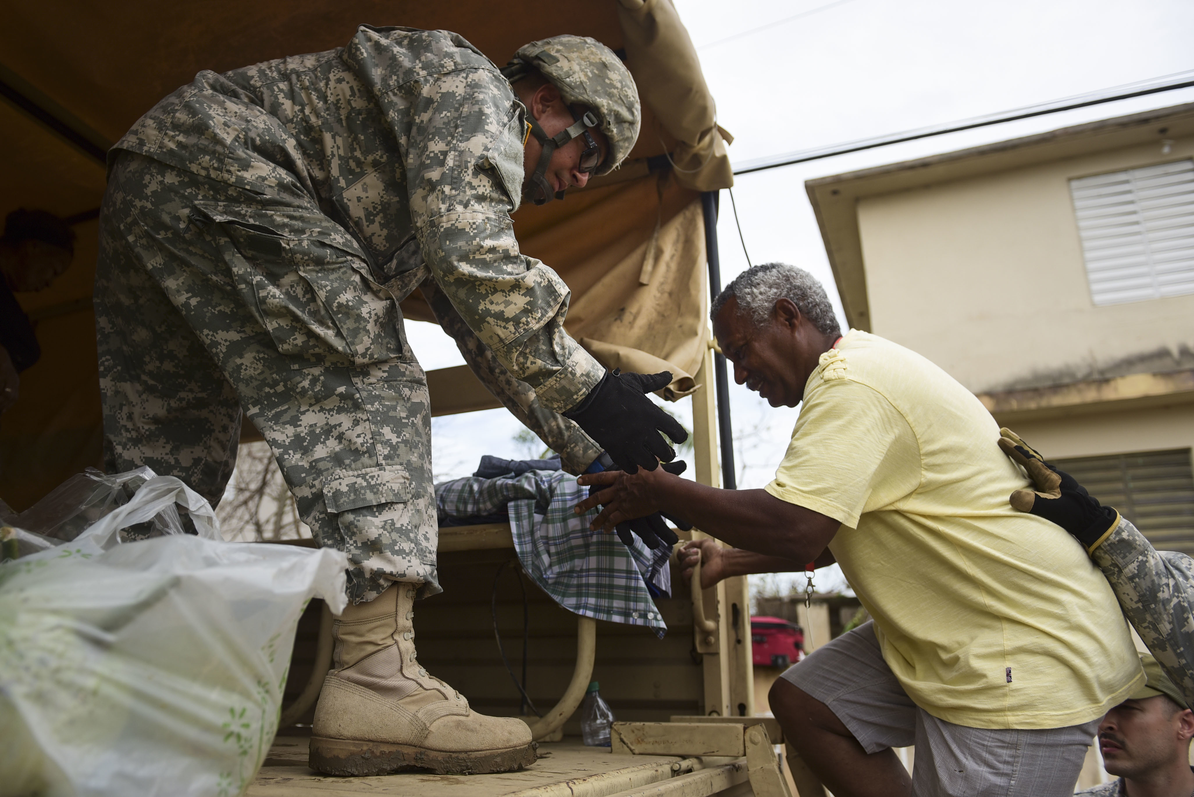 National Guard personnel evacuate Maria victims