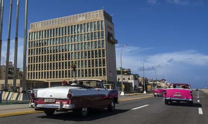 Tourists ride classic convertible cars on the Malecon beside the United States Embassy in Havana, Cuba, on Oct. 3, 2017. (AP Photo/Desmond Boylan, File)