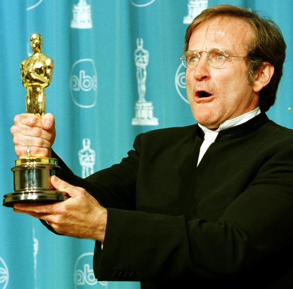 Actor Robin Williams holds the Oscar he won for Be