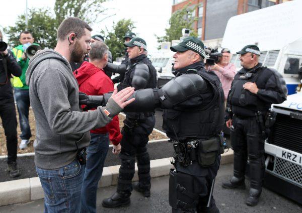 Riot police stop a Republicanparade