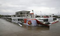 Typhoon Kills 12 in Philippines, Heads to Southern China