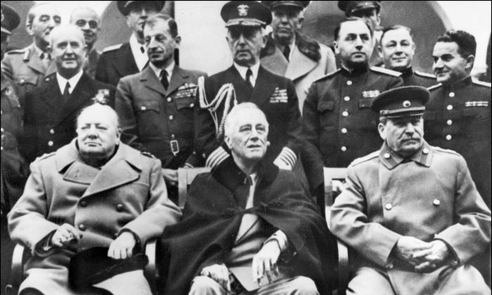 British Prime Minister Winston Churchill (L), US President Franklin Delano Roosevelt (C) and Secretary general of the Soviet Communist Party Joseph Stalin (R) pose at the start of the Conference of the Allied powers in Yalta, Crimea, on Feb. 4, 1945. (STF/AFP/Getty Images)