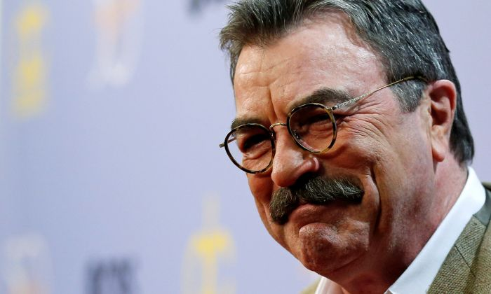"""Actor Tom Selleck poses as after arriving for the taping of """"The Carol Burnett 50th Anniversary Special"""" at CBS Studios in Los Angeles, Oct. 4, 2017. (REUTERS/Mario Anzuoni)"""