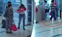 The Moment a Woman Gives Her Baby Away to Complete Stranger at Russian Airport