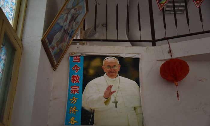 A poster of the Pope is seen in a closed church in Xincun, in China's central Henan Province on Aug. 12, 2018.  (Greg Baker/AFP/Getty Images)
