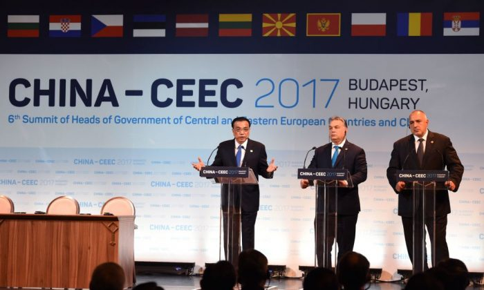 (L-R) Chinese Premier Li Keqiang, Hungarian Prime Minister Viktor Orban, and Bulgarian Premier Boyko Borisov speak during an economic forum in Budapest attended by 16 central and eastern European leaders on Nov. 27, 2017. (Attila Kisbenedek/AFP/Getty Images)