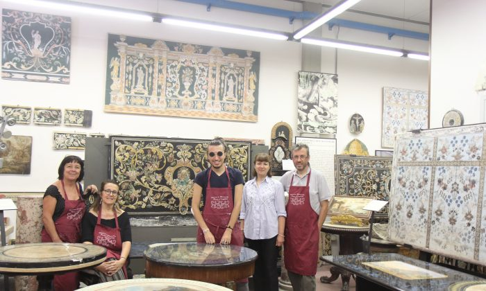 The Bianco Bianchi workshop in Pontassieve, Italy on July 11, 2018. (L) Sylvia Berlincioni, Elisabetta Bianchi, Leonardo Bianchi, Paola Lupelli Bianchi and  Alessandro Bianchi surrounded by historic pieces of scagliola. (Lorraine Ferrier/The Epoch Times)