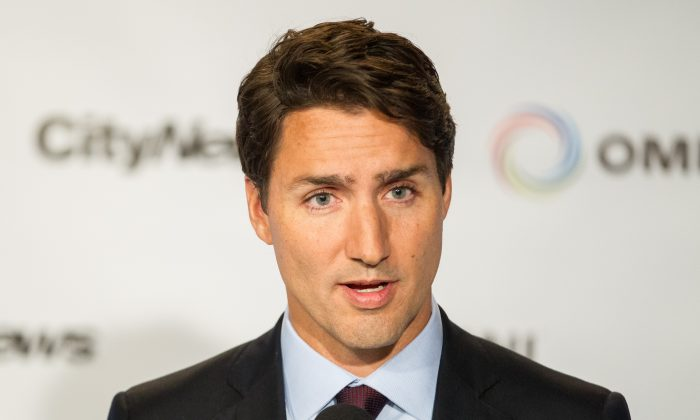 Liberal leader Justin Trudeau speaks to reporters during a press conference following the first federal leaders debate of the 2015 Canadian election campaign in Toronto,  Aug. 6, 2015.  Victorious in 2015, Trudeau will face the voters again on Oct. 21, 2019.  (GEOFF ROBINS/AFP/Getty Images)