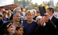 German Chancellor Merkel Takes Gamble With New Immigration Law