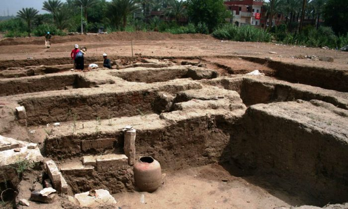 This undated photo released by the Egyptian Ministry of Antiquities, shows a large Roman bath and a chamber likely for religious rituals, that was recently discovered in the town of Mit Rahina, 20 kilometers, or 12 miles, south of Cairo, Egypt. (Egyptian Ministry of Antiquities via AP)
