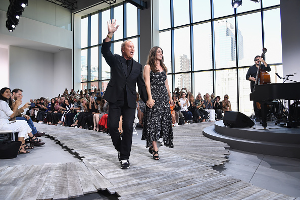 96e00a98f7 Designer Michael Kors and singer Sara Bareilles walk the runway at the Michael  Kors Collection Spring