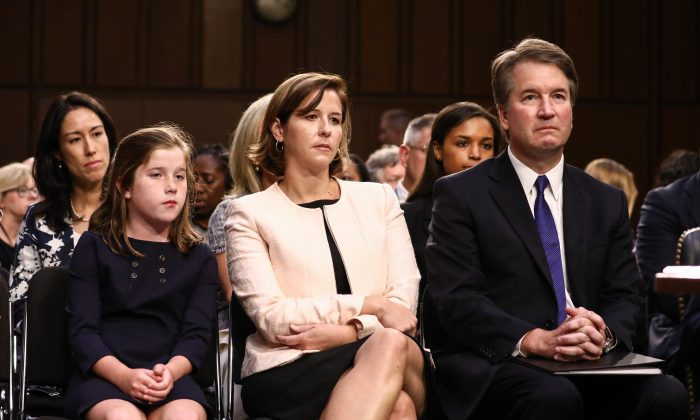 Judge Brett Kavanaugh sits next to his wife Ashley Kavanaugh, and daughter Liza, before the Senate Judiciary Committee on the U.S. Supreme Court at the Capitol in Washington on Sept. 4, 2018. (Samira Bouaou/The Epoch Times)