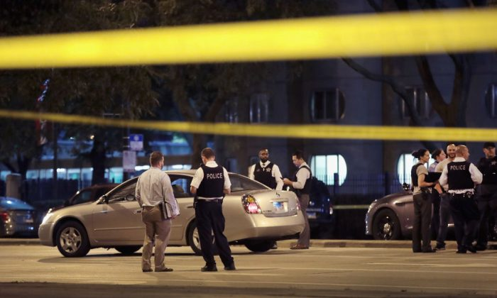 Police investigate the scene of a shooting near the Chinatown neighborhood where four people were shot in an apparent road rage incident on September 19, 2018 in Chicago, Illinois. A 6-month-old infant boy and a thirteen-year-old girl were among the victims.  (By Scott Olson/Getty Images)