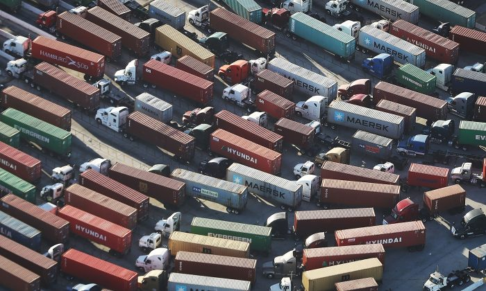 Trucks prepare to haul shipping containers at the Port of Los Angeles in San Pedro, Calif., on Sept. 18, 2018. (Mario Tama/Getty Images)