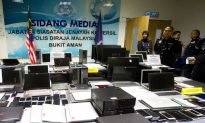 93 Chinese, 6 Malaysians Arrested for Alleged Phone Swindle