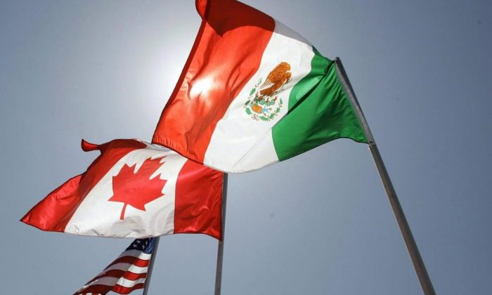 The flags of the United States, Canada, and Mexico. (The Canadian Press)