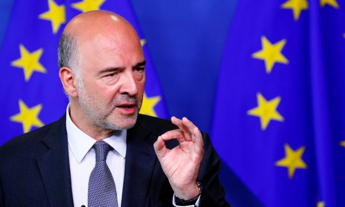European Economic and Financial Affairs Commissioner Pierre Moscovici speaks during a news conference in Brussels, Belgium, on Aug. 20, 2018. (Francois Lenoir/Reuters)
