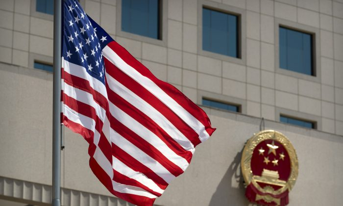 The American flag outside the Bayi Building before a welcome ceremony for U.S. Defense Secretary Jim Mattis in Beijing on June 27, 2018. (Mark Schiefelbein/ Reuters)