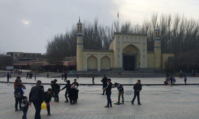 Children play outside the Id-kah mosque in Kashgar, in China's western Xinjiang region, on Feb. 18, 2018. (Ben Dooley/AFP/Getty Images)