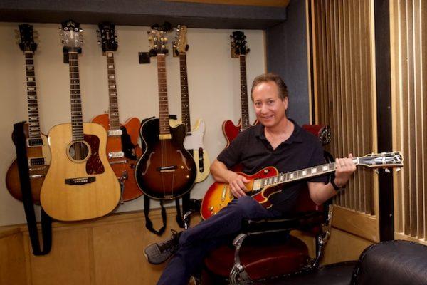 Jack Bookbinder playing guitar