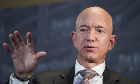 Jeff Bezos, Amazon founder and CEO, speaks at The Economic Club of Washington's Milestone Celebration in Washington, on Sept. 13, 2018. (AP Photo/Cliff Owen)