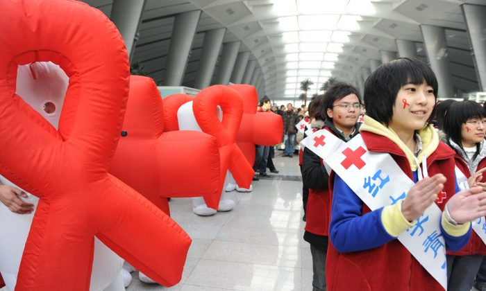 Volunteers from Red Cross China take part in an AIDS-awareness event on World AIDS Day at Beijing's south railway station on December 1, 2009, to call for better government support for HIV/AIDS victims in China. (AFP/AFP/Getty Images)