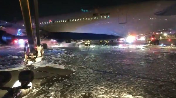 Firefighters douse the landing gear