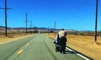 LA Deputies Push Woman's Stalled Electric Wheelchair