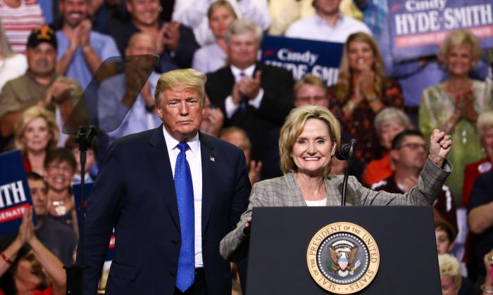 """President Donald Trump and Sen. Cindy Hyde-Smith (R-Miss.) at a Make America Great Again rally in Southaven, Miss., on Oct. 2, 2018. Hyde-Smith has caused a media storm over remarks she made about """"public hangings,"""" with opponents accusing her of being racist. (Charlotte Cuthbertson/The Epoch Times)"""