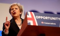End Divisions or Put Brexit at Risk, Britain's Prime Minister Theresa May Tells Party