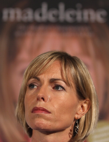 Kate McCann in front of a poster