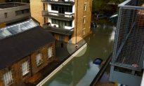London Schoolboy Goes to School Despite Flood
