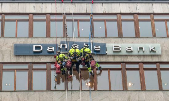Workers maintaining the Danske Bank sign in central Stockholm, Sweden in this file photo. (Leif Blom/AFP/Getty Images)