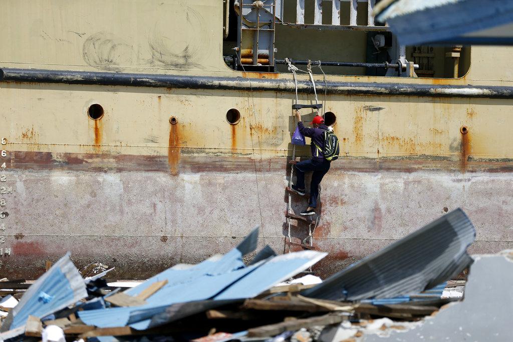 a man climbs a ferry